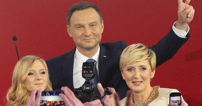 Enraged voters menace political status quo in Spain, Poland