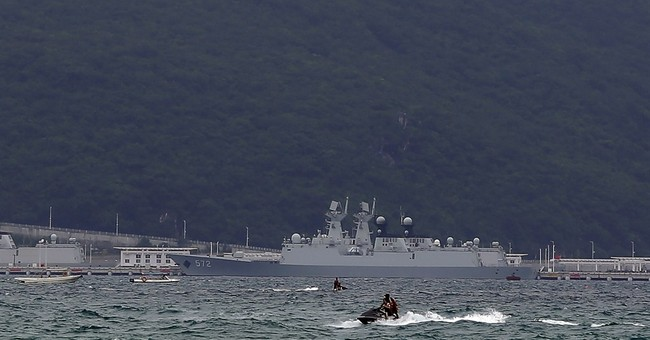 China's army plays down South China Sea island-building