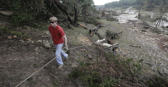 AP PHOTOS: A look at aftermath of torrential rains, storms
