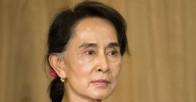 Myanmar's Suu Kyi is missing from global meeting on Rohingya