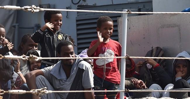 AP NewsBreak: EU to relocate 40,000 immigrants within union