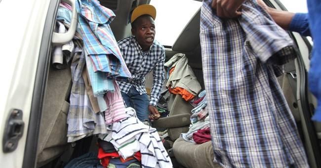 Outfits on wheels: In Zimbabwe, cars are used clothing shops