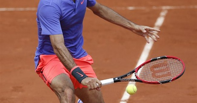 The Latest: Dzumhur lives the Federer dream at French Open