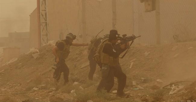 Islamic State suicide attacks in Iraq's Anbar kill 17 troops
