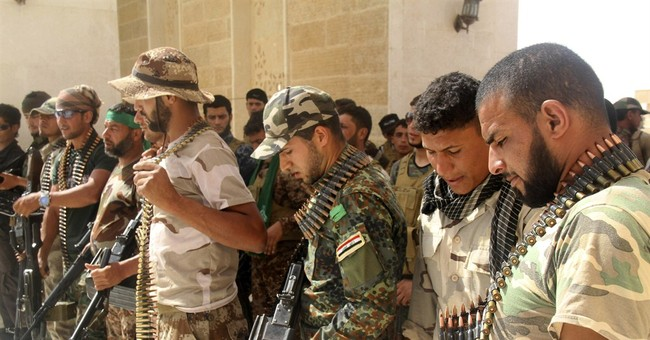 The Latest on IS: Detainees killed at theater in Syria ruins