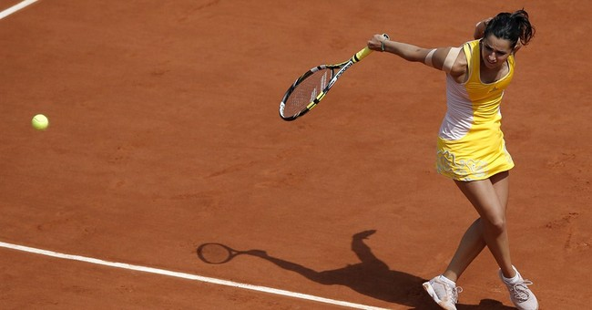 The Latest: 5 more seeds, including Halep, exit French Open