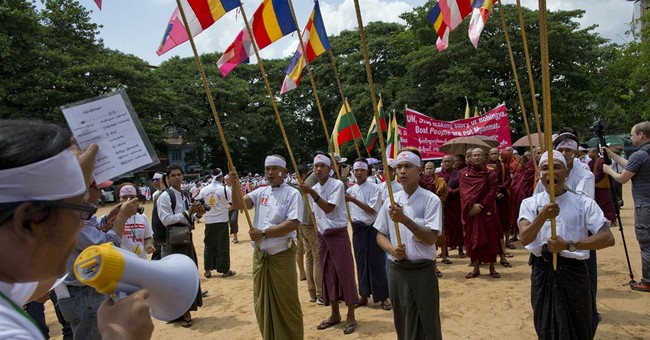 Buddhists in Myanmar deny boat people are Rohingya