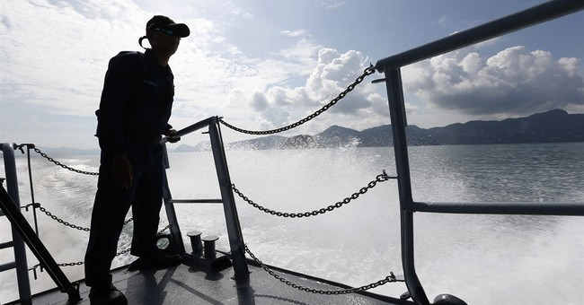 Image of Asia: Standing watch on Malaysian navy ship at sea