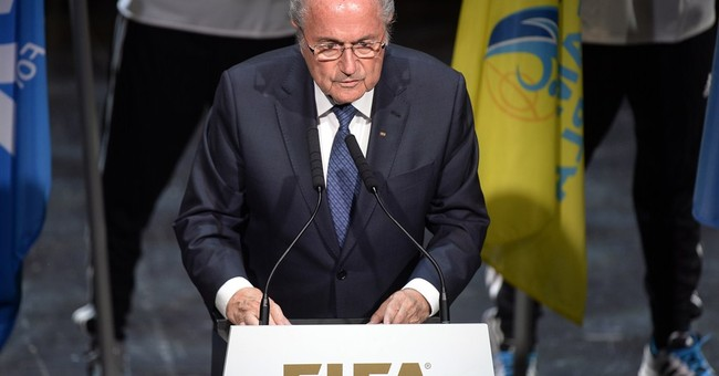 Defiant soccer chief resists calls to resign amid scandal