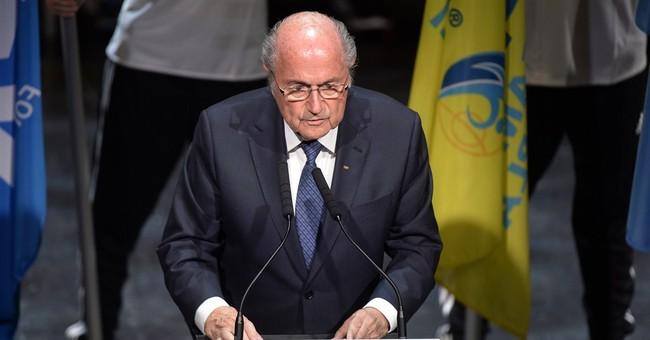 Blatter wins re-election despite FIFA corruption scandal