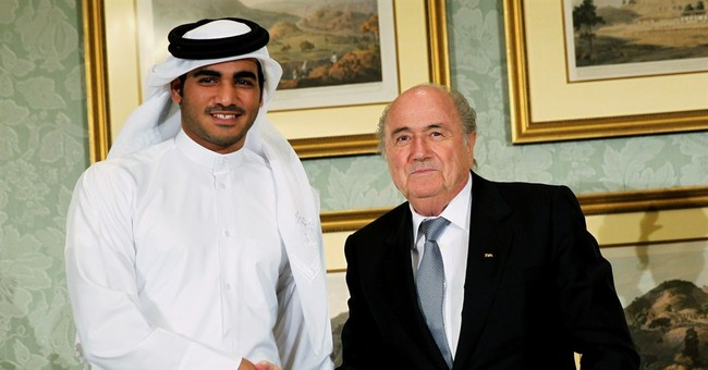 Qatar says it will go forward with plans to host World Cup