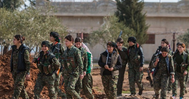 Kurdish fighters in Syria on the march against IS militants