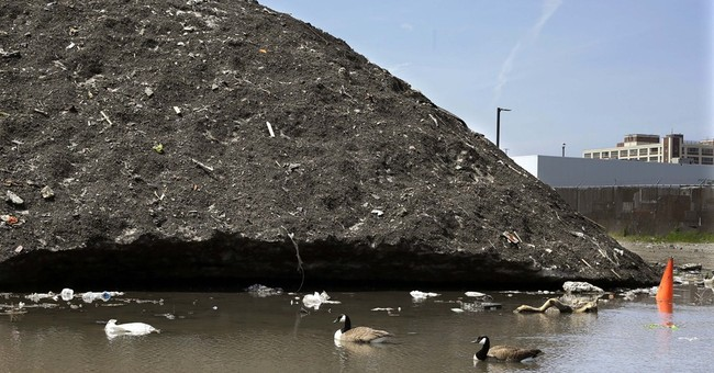 Boston still has snow piles _ and they're filled with trash