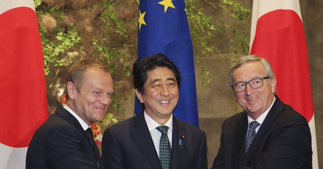 Japan, EU agree to step up defense, economic ties