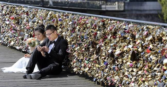 Eternal love dashed: Paris lovers' locks to be dismantled