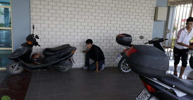 Migrants hide under trucks to board Italy-bound ferries