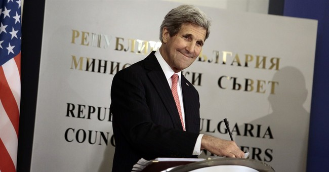 Kerry says he's going to give 'a big hug to Paris'