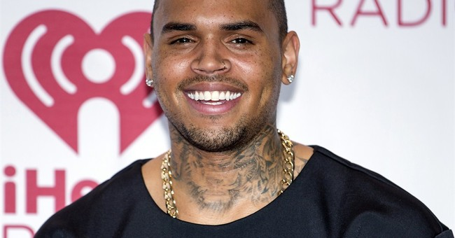 Judge revokes Chris Brown probation in Rihanna assault case