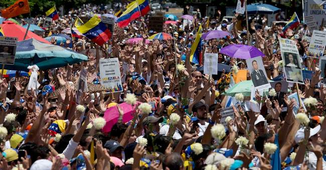 Venezuelans mass for year's largest anti-government protests