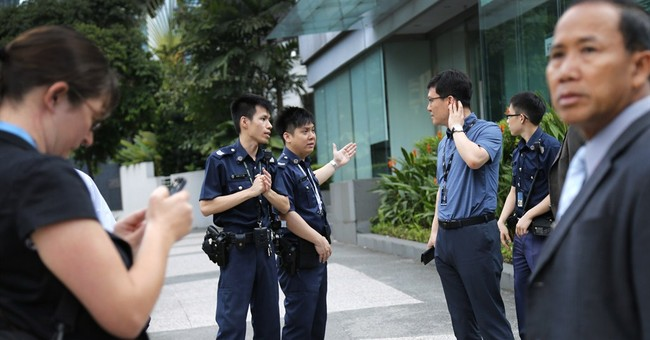 Security stepped up at Singapore meet after police shooting