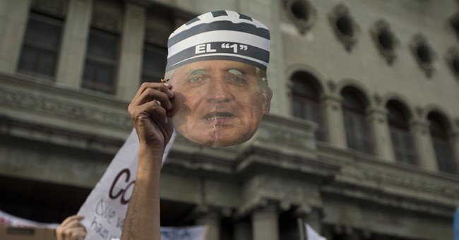 Guatemalan protesters demand president quit over corruption