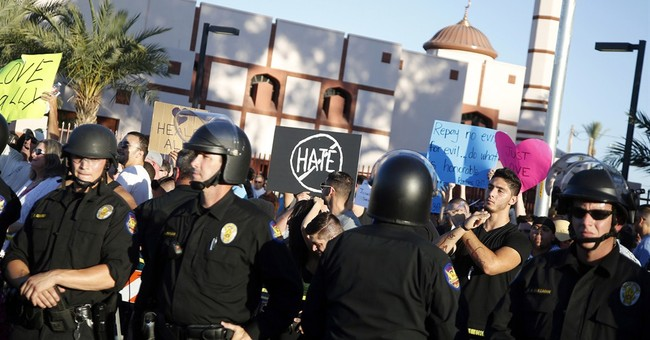 Protesters gather at Phoenix mosque under close police watch