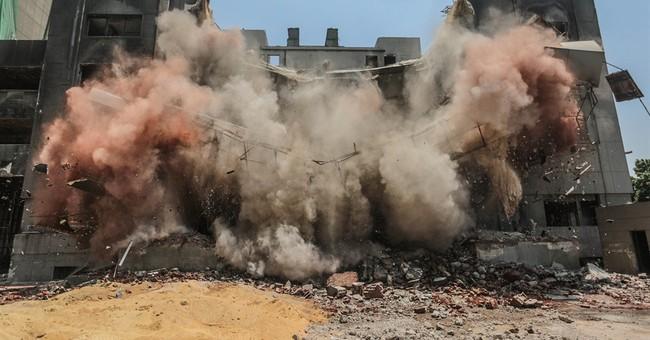 Demolition of torched HQ of Mubarak's old party begins