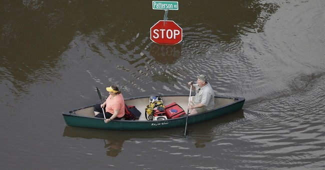 Latest on weather: Dallas-area officials warn of flood risk