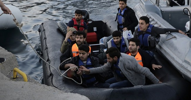 Germany, France demand changes to EU refugee-sharing plan