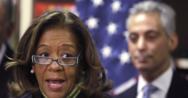 Officials: Chicago schools chief resigns amid federal probe