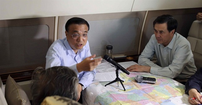The Latest on China Boat Sinking: Rescuers hear survivors