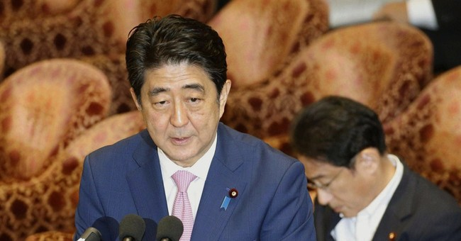 Japanese PM Abe apologizes for heckling opposition lawmaker