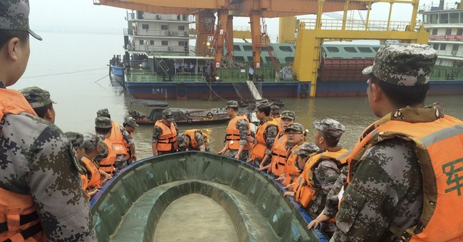 Latest on China Boat Sinking: Over 1,000 sent to help search