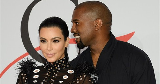 Pharrell honored, Kimye steals the show at fashion awards