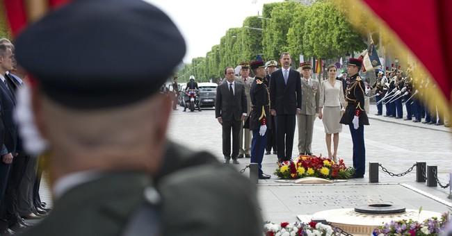 Spanish royals in Paris for visit; honor crash workers