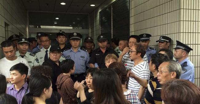 Relatives of China boat passengers turn anger on govt
