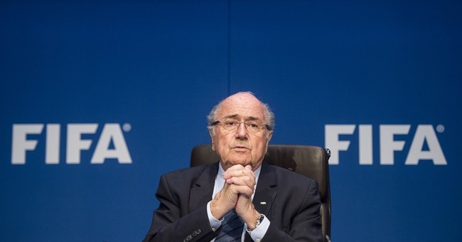 Blatter's 17-year rule in soccer marked by growth, scandal