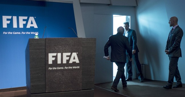 Key questions: Why did Blatter resign and what now for FIFA?
