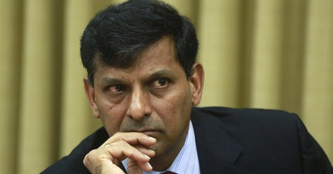 India's central bank cuts key interest rate to boost growth