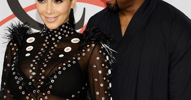 Kim Kardashian says dress caught fire; Pharrell rescued her
