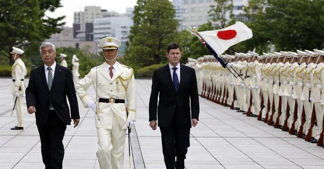 In Tokyo, Philippine leader criticizes China over sea moves