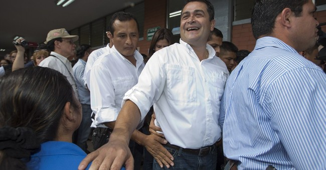 Honduran leader acknowledges campaign funds tied to scandal