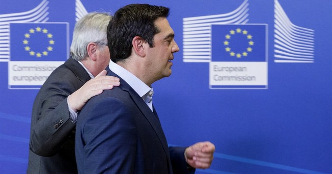 Greek leader defends bailout plan in talks with creditors
