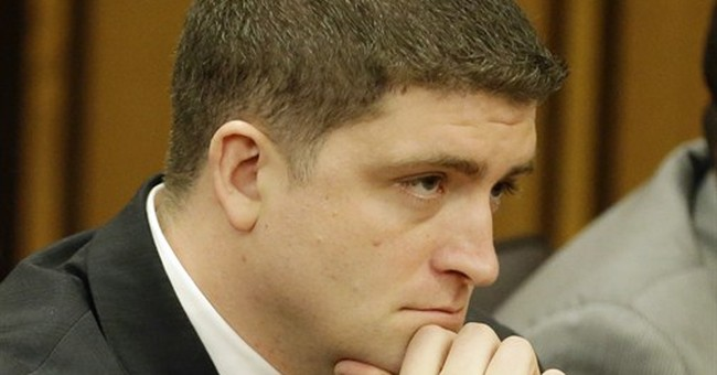 Ohio officer acquitted in 137-shot case faces assault charge