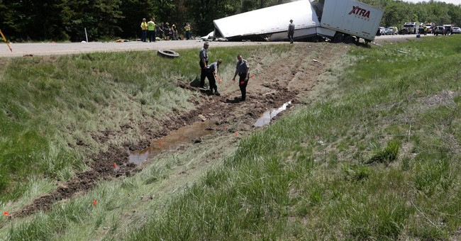 Italian honeymooner among 3 dead in bus-truck highway crash