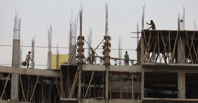 Global watchdog warns on economic growth, cuts US forecast