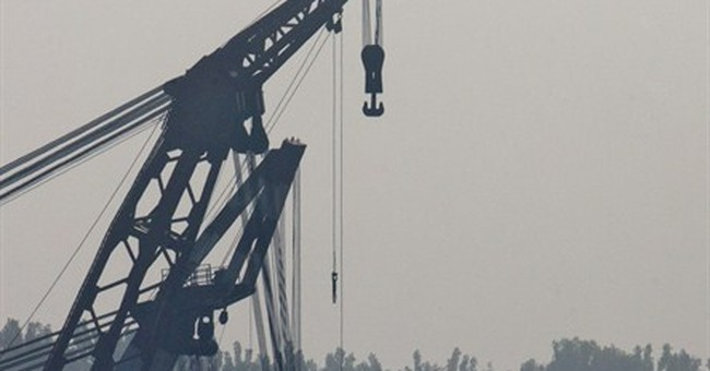 The Latest on China Boat Sinking: Divers find more bodies