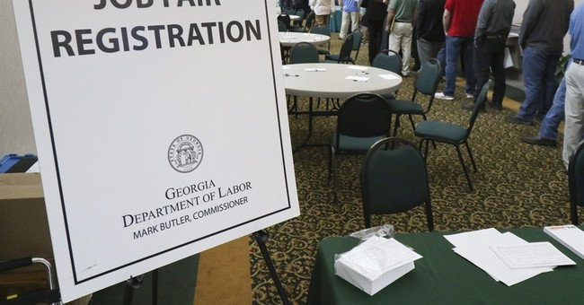 Applications for US jobless aid remain low at 276,000