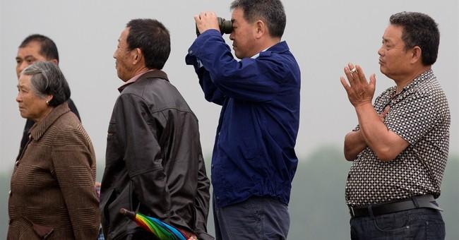 China controls info, isolates boat victims' relatives