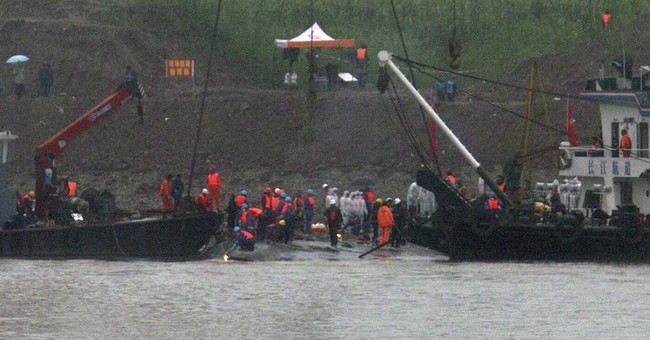 The Latest on China Boat Sinking: Holes being cut into hull